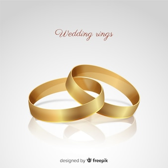 Realistic golden wedding rings background