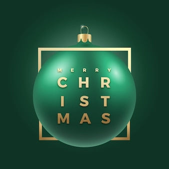 Realistic green christmas bauble on classy dark background with modern golden glitter typography greetings in a frame. winter holiday decoration sticker, card or poster. new year 3d ball banner