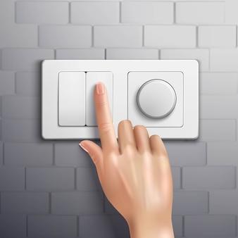 Interruttore di mano realistico premendo con l'indice sul muro di mattoni grigio