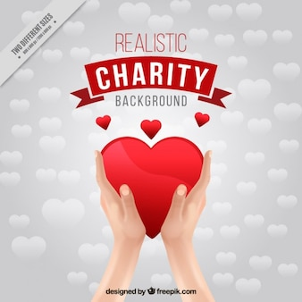 Realistic hands with heart background of charity