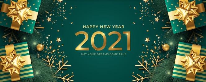 Реалистичный баннер с новым годом с зелеными и золотыми подарками
