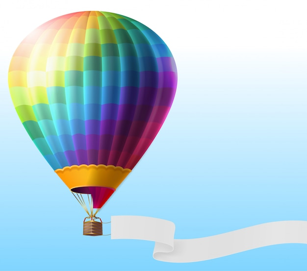 Realistic hot air balloon with rainbow stripes, flying on blue sky with blank ribbon