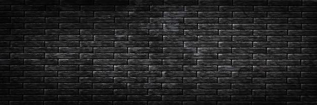現実的な孤立したパノラマの黒いレンガの壁