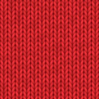 リアルなニットの質感、ニットのシームレスなパターン、または赤いウールのニットウェアの飾り