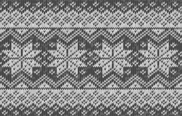 Realistic knitted background with snowflakes. vector seamless texture of wool gray knit. norwegian pattern. template of knitwear for wallpaper, christmas and new year greeting card, webpage backdrop.