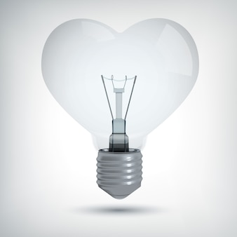 Realistic light bulb design concept in shape of heart on gray  isolated