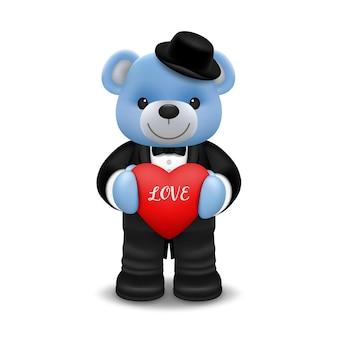 Реалистичная маленькая милая улыбающаяся кукла-медведь носит смокинг персонажа, держащего красное сердце и стоящего на белом фоне. день святого валентина и дизайн иллюстрации концепции любви.