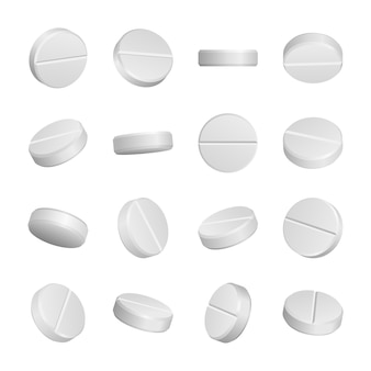 Realistic medical pills isolated on white .