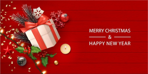 Realistic merry christmas banner with gift box and christmas decorations