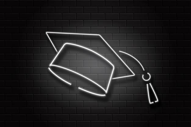 装飾とカバーのための壁の背景に現実的なネオンサイン卒業の帽子。教育、卒業、学校に戻るの概念。