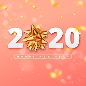 Realistic new year 2020 wallpaper with golden gift bow
