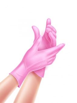 ピンクの滅菌手袋を着用して現実的な看護師の手