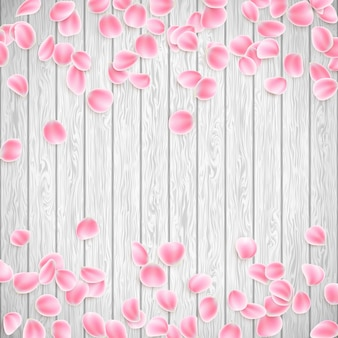 Realistic petals on a white wooden background.