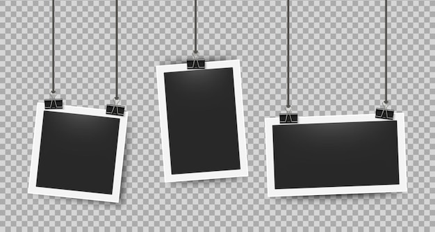 Realistic photo frames clipped on ropes. retro 3d picture frame on white border for cameras photography. vector illustration blank photoframe set on transparent background