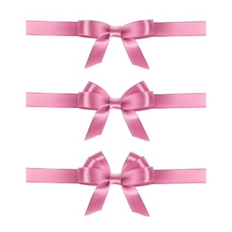 Realistic pink ribbons and bows on white background.
