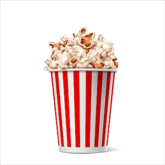 Realistic popcorn in red white striped paper bucket. vector movie, theater snack container.