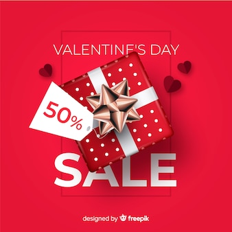 Realistic present valentine's day sale background