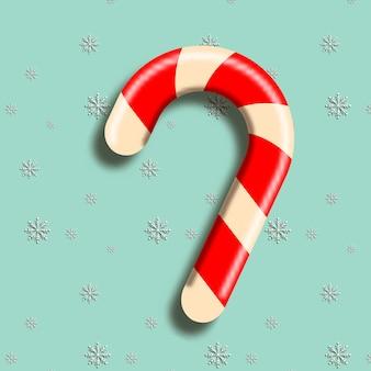 Реалистичная красно-белая полосатая рождественская конфета на снежном фоне