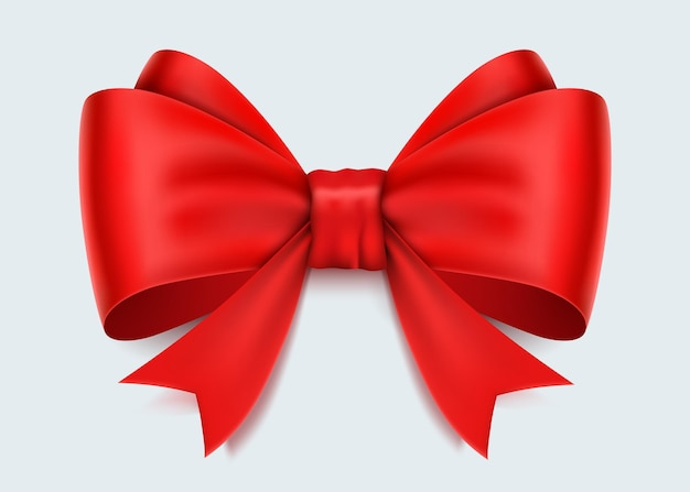 Realistic red bow isolated on white.