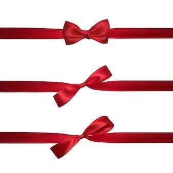 白で隔離される水平の赤いリボンと現実的な赤い弓。装飾ギフト、挨拶、休日の要素。