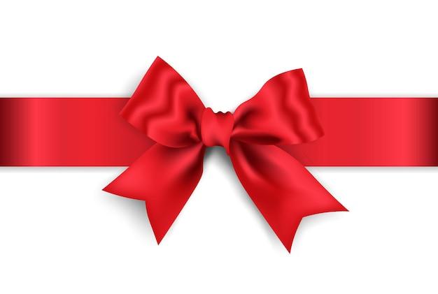 白い背景で隔離の赤いワイドリボンと現実的な赤い弓