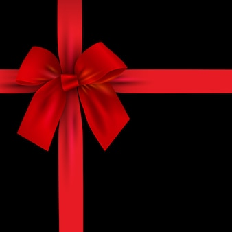 Realistic red bow with ribbon isolated on black