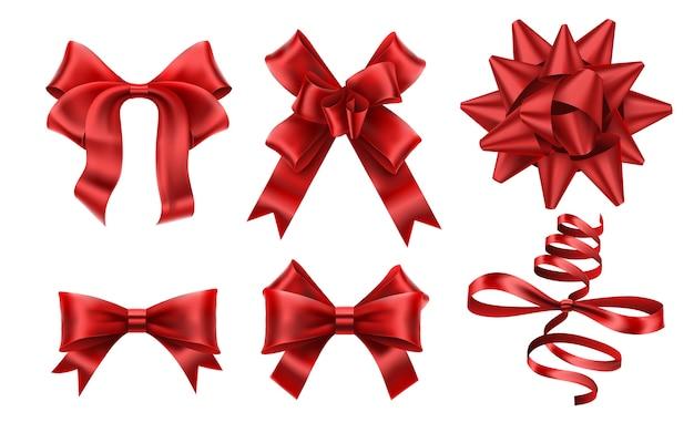 リアルな赤い弓。装飾的なクリスマスギフトリボンの弓、クリスマスまたはロマンスの装飾要素。
