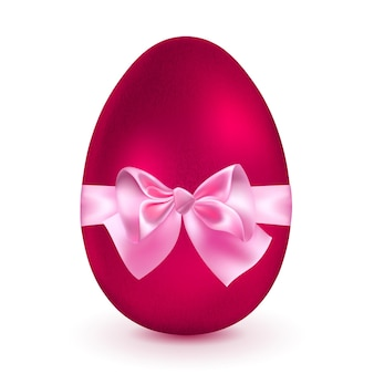 リアルな赤い卵はピンクのリボンをリボンで結びました。
