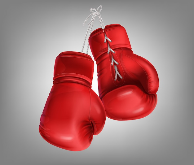 Realistic red pair of leather boxing gloves with lacing