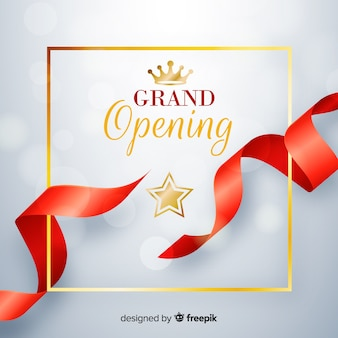 Realistic red ribbon with golden details grand opening background