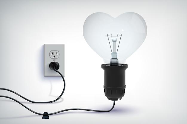 Realistico concetto romantico di lampadina cablata realistica a forma di cuore con presa di corrente isolata