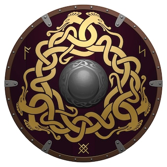Realistic round shield of viking. medieval wooden armor with iron details. shield is decorated by ancient runes and original golden ornament. interwoven nordic dragons on a dark brown field.