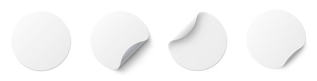 Realistic set white round paper adhesive stickers with curved corner and shadow.
