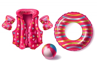 Realistic set with pink rubber ring, life jacket and armbands with pattern, inflatable beach