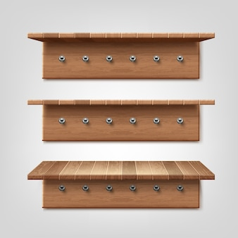 Realistic set of wooden shelf with clothes hanger hooks isolated on wall background