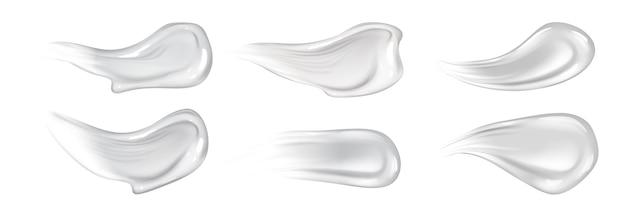 현실적인 피부 크림 스트로크 세트. 사실주의 스타일로 그려진 흰색 액체 천연 컨실러 또는 선 스크린 밤 얼룩 모음