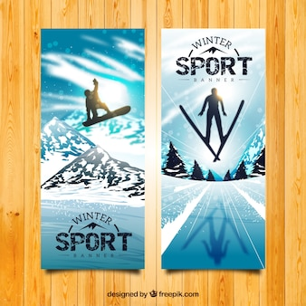 Realistic snowboard and skiing banners