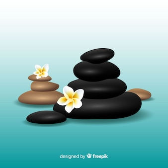 Realistic spa stones with flowers background