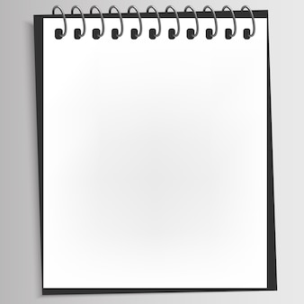 Realistic spiral blank notebook with back cover was opened on white desktop. Premium Vector