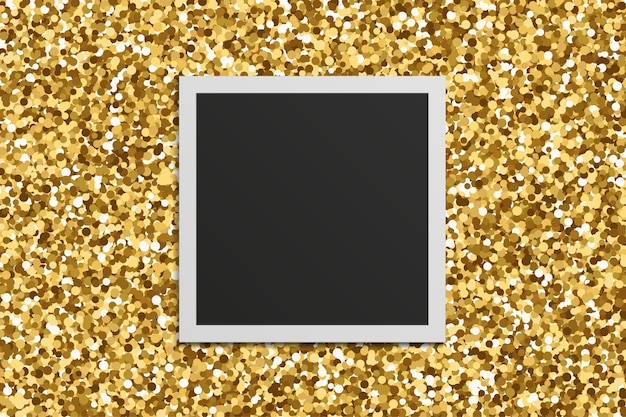 Realistic square foto frame with shadows on gold glitter texture background.