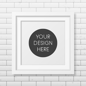 Realistic square white frame  on the brick wall