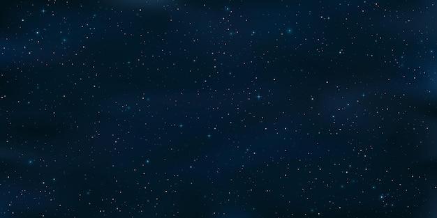 Реалистичное звездное небо. сияющие звезды в ночном небе. объекты галактики. космический фон или обои для вашего дизайна.
