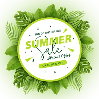 Realistic summer sale banner with tropical leaves