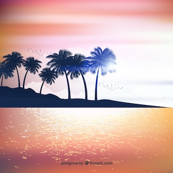 Realistic summer sunset with palm silhouettes