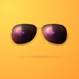 Realistic sunglasses in a gold frame on a yellow background.