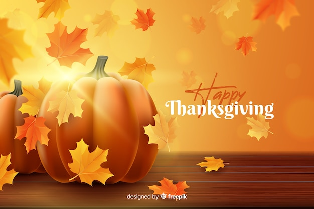 Realistic thanksgiving background with dried leaves