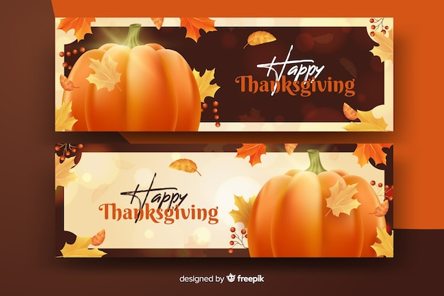 Realistic thanksgiving banners with pumpkin and dried leaves