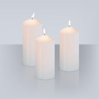 Realistic three candles with flame on grey background with mirror reflection.