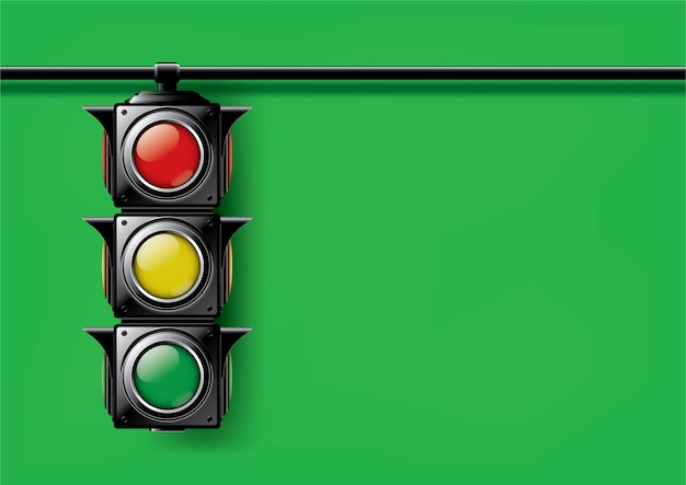Realistic traffic lights isolated on green background.