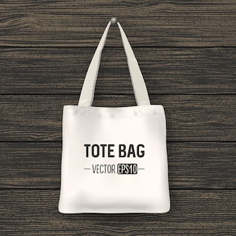 Realistic vector white textile tote bag. closeup on wood background. design template for branding, mockup. eps10 illustration.